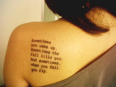 Tattooed on a girl's back - words from Sandman